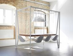 DuffyLondon Swing Table turns even the most boring board meeting or an everyday meal into a fun affair! Looove this!