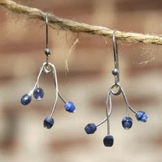 Earrings are made of Czech glass and silver plated wire. They remind me of blue flower bells or church bells or any bells that come to mind.