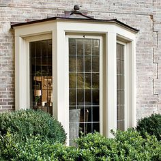 Bay window with leaded-glass inserts! Love the finial!!
