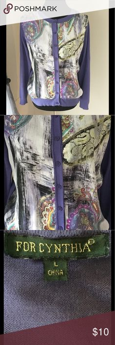 Satin Front Cardigan Sweater by For Cynthia Large Cardigan sweater by For Cynthia.  Sweater portion is solid purple. Crew neck, button front. Front is multi color, Paisley inspired print.  Front is Satin masterial.  Size large.  Good condition.  Important:   All items are freshly laundered as applicable prior to shipping (new items and shoes excluded).  Not all my items are from pet/smoke free homes.  Price is reduced to reflect this!   Thank you for looking! For Cynthia Sweaters Cardigans