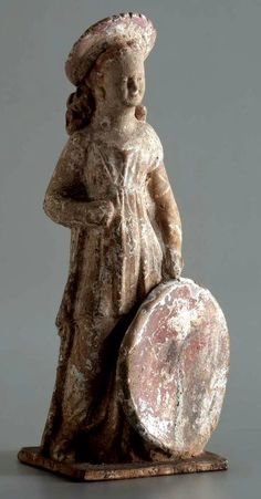 hellenismo:   Figurine of a girl holding a... | Roman and Greek Art