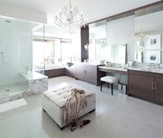 Elegant bathroom with veneer cabinets paired with white marble countertops flanked by drop-down vanity paired with upholstered vanity stool. Bad Inspiration, Bathroom Inspiration, Bathroom Ideas, Bathroom Layout, Bath Ideas, Dream Bathrooms, Beautiful Bathrooms, Luxury Bathrooms, Glamorous Bathroom