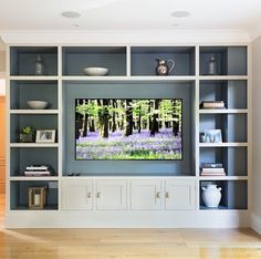 Joinery configuration like this to take up tv wall and conceal all ...