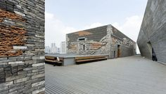 Completed in 2008 in Ningbo, China. In Iwan Baan's website, we found one of the latest works he photographed, the Ningbo Historic Museum designed by Wang Shu, Amateur Architecture. Museum Architecture, Brick Architecture, Chinese Architecture, Contemporary Architecture, Architecture Details, Contemporary Art, Ningbo, Stone Facade, Design Museum