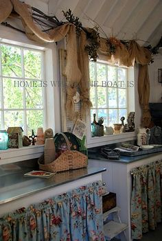 burlap. LOVE the style of this kitchen, and curtains for doors. - Melanie