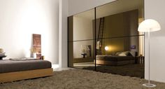 mirror-finish-wardrobe-with-relaxing-bed love the glass wardrobe doors Glass Wardrobe Doors, Sliding Wardrobe Doors, Sliding Doors, Living Room Furniture, Home Furniture, Italian Furniture Design, Interior And Exterior, Interior Design, New Homes