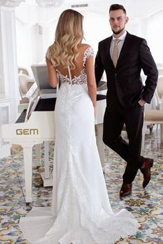 Mia is a gorgeous wedding dress. Beautiful embroided lace on a delicate tulle with buttons to fasten at the back. Mia is a fitted style dress with Stunning  detailed  lace feature at the centre back. This gorgeous Mia dress is exclusively available at Luella's Bridal.