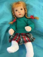 Kathe Kruse doll, with Brai hair and red and green dress, 10 1/2 inches, Germany