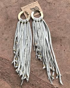 Handcut recycled vintage leather fringe on vintage gold hoop earrings with gold bead detail. Measures 7 inches long Very lightweight Super cool Angela Aldatz Designs