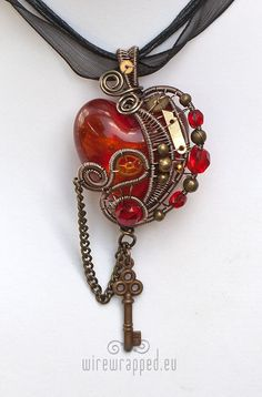Love the color and the intricate filigree work on this #necklace Red-orange #steampunk #heart with key @La Claryce