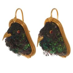 """Victorian Taxidermy Hummingbird Earrings  England  Circa 1865-1870  Taxidermy hummingbird earrings in 18k gold with original leather, velvet, and satin fitted box. Gold beaks and red glass eyes. Gold ear wires. English registry marks on back. Made by Harry Emanuel, London. Drop measures approximately 1 3/8"""".  Price  $5,500"""