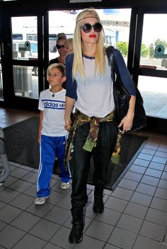 Gwen Stefani was funky in a baseball tee, round sunglasses, shiny black pants, and a camouflage sweater at LAX.