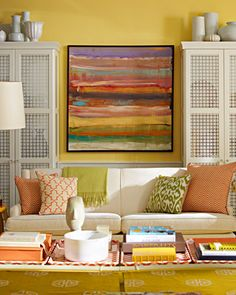 Madeline Weinrib Orange Chevron Blockprint Pillows, Orange Brooke Blockprint Pillow, Celery Luce Ikat Pillow, and Goldenrod Bella Cotton Carpet.