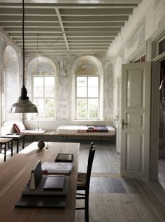 Timber flooring, beam ceiling, height & the right windows & doors. Chic minimalism at its best.
