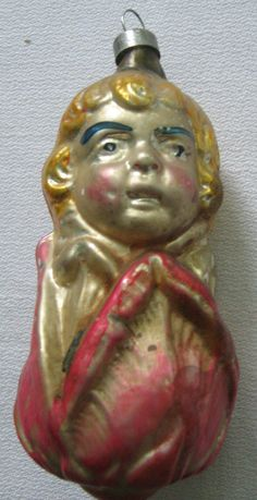 Wonderful glass ornament of a girl poking her head out of a tulip