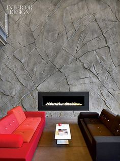 Hit the Slopes: Ski Rossignol Headquarters by Hérault Arnod Architectes   Reception's sprayed-concrete fireplace surround. #design #interiordesign #interiordesignmagazine #fireplace #architecture #furniture