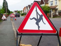 'Men at Work'  (12 May 2015). by steve came. roadworks in Camberley Surrey.