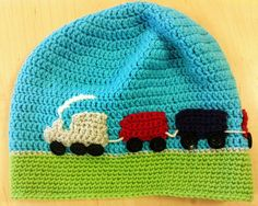 Choo choo! Super simple crochet kids hat. The carriages are made seperately and stiched on to give extra texture and buttons become shiny train wheels. Hat and toy!