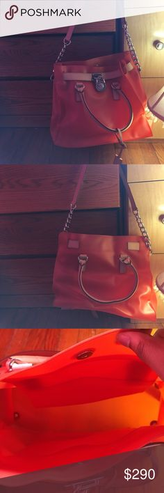 Large orange Michael Kors Hamilton Please note this bag was bought on posh. Rare large orange  michael kors jelly Hamilton . Please do not buy without asking I will not ship. No rips stains or tares. Used once. A little bent out of shape due to storage but it could be bent back into shape. Michael Kors Bags Shoulder Bags