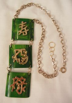 Bold rare Asian symbols rectangular marbled green Bakelite Necklace    Offered by Ruby Lane shop Wear Me Out Vintage Jewels