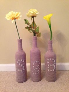 Decorated wine bottles with initials for a wedding present
