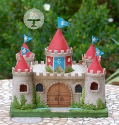 """Castle cake for a boy, based on an 7"""" square. The small 3"""" turret on top makes a fun single serving for the celebrant."""