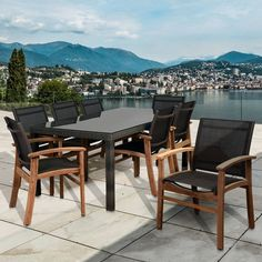 Malden 9 Piece Teak/Wicker Rectangular Dining Set is the perfect match for every patio and will give your backyard the class and elegance for outdoor dining. This collection combines luxury, beauty, comfort, and an affordable price. This 9 piece dining set seats 8 people and includes a distressed gray table with clear tempered glass top and teak arm chairs with polyester brown mesh. The durable textile sling is made with Weathernet® which is tightly secured to the main seat frame. The se...