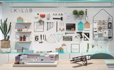 the 'LKLAB' is built inside the office, which is used by designers to build models and to convey their ideas and concepts to clients in a fun and interactive display.
