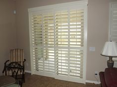 Sliding glass door with the plantation shutters closed but the louvers are all opened.