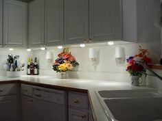 led kitchen lighting, white under cabinet lights and red toe kick
