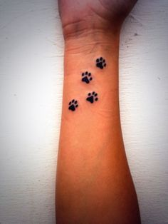 Definitely want a paw print tattoo, but prob would want my dog's actual paw print More