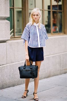 Harleth Kuusik was seen on the street during fashion week wearing a nautical stripe look. Pairing a boxy striped shirt with structured navy shorts, the model completed her striking off-duty look with a black tote bag and black heels. Modest Summer Fashion, Summer Outfits, Sporty Chic, New Yorker Mode, Casual Fashion Trends, Vogue, Inspiration Mode, New York Fashion, Net Fashion