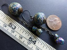 Sabaism. Textured iridescent polymer earrings by fancifuldevices