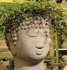 Buddha Head Planter gives your favorite plants unexpected, yet serene character. One of the most popular in the series of cast stone head planters, this Buddha Planter is original garden sculpture, cr