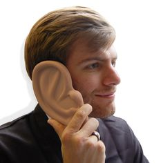 Just for fun..... iPhone 4 Ear Shaped Case - comically huge ear shaped phone cover. Phone becomes the eardrum of this elephant-sized silicone case.