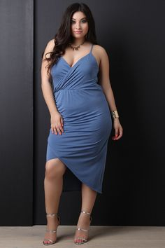 919ea4374b3 This plus size dress features a surplice v- neckline