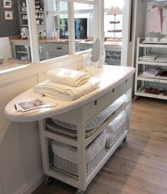 Love the idea of having an ironing board on wheels and how great would it be if the board folded down on the end of the cart until needed?