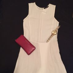 Zara Chic Romper Chic white summer romper! You can dress this play suit up or down, throw on some wedges and get ready for the compliments! Color is white and it has a liner (thank goodness for no see thru panties!) great condition! Full back zipper. Size medium. True to size. Zara Other