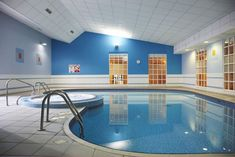 Swiming Pools Stainless Hand Rails With Indoor Pools Also Pool Tubs And Above Ground Liners Besides In Ground Ladders  Pool Paint  In Ground Pumps  Wall Sign  Wall Painted Design  Ceiling Fans With Lights   The Benefit in Having Amazing Indoor Pools