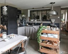 This home, which used to be a barn, belongs to David and Christelle Lechevallier and is located in the village of Villez-sous Bailleul, in Normandy, France. Christelle is a second-hand dealer and she decorated her rooms with a mix of industrial and vintage styles.