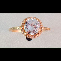 ‼️HP‼️ 18k Rose Gold Cubic Zironia Beautiful 18k rose gold over sterling silver ring. 2 1/3 ct tw of cubic Zironia. Very elegant ring! Photo gives a blue tint but it is clear and very sparkly! Great details on band and setting. B. Brilliant Jewelry