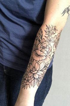 Floral half sleeve completion by Leah B at Waukesha Tattoo co in Waukesha, WI