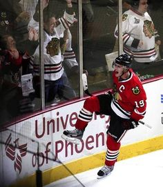 Jonathan Toews celebrates his game-tying goal in the third period against the Red Wings.