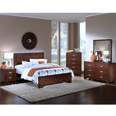 Bring home the beautiful transitional style of our Carter King Bedroom Package. This collection is designed to bring major style to small spaces. With the clean design and beautiful, rich brown color, these pieces will match any existing decor. Carter is available in both King and Queen sizes.