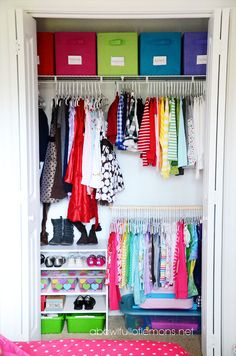 Tiny clothes mean a two-tiered system can be totally functional (no maxi dresses skimming the floor here!). Hang a second rod or place shelves in the lower half of the closet to make it work twice as hard. See more at A Bowl Full of Lemons »  - GoodHousekeeping.com