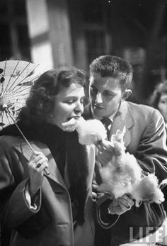 Ohio State Univ. student Bud Shively and his date Vivian DeMaria enjoying some cotton candy, 1949