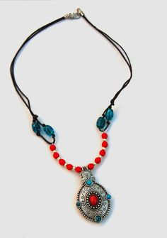 A very unique design combining a silver pendant with turquoise and red glass beads, strung on waxed linen cord for a stylish boho look!    $30