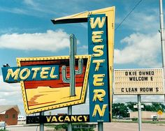 A fine art photograph of the Western Motel Sign in Sayre, Oklahoma.  #Route66…