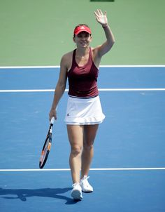 Simona Halep Photos - Simona Halep of Romania waves to the crowd after winning…