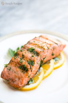 Grilled Salmon with Dill Butter ~ Simple and easy, grilled salmon with dill butter and lemon. Low carb and paleo too! #FourthOfJuly ~ SimplyRecipes.com
